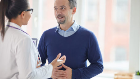Man speaking with doctor about Genitourinary Cancer Care